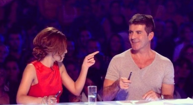 Cheryl Cole with Simon Cowell in her throwback picture