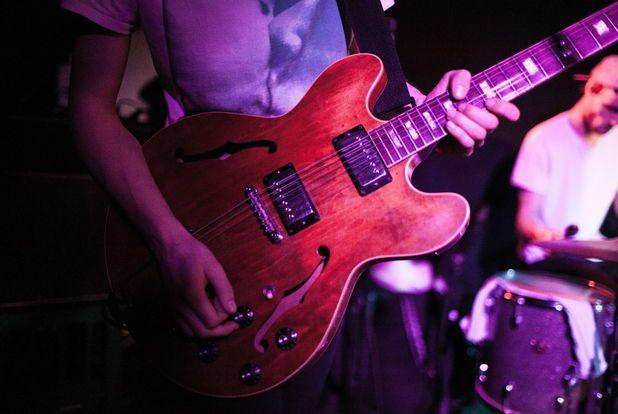 Guitarist performing at a concert