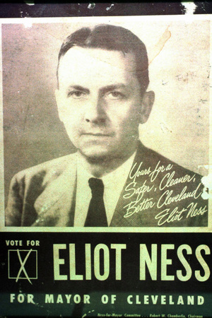 A framed poster from Eliot Ness's unsuccessful run for mayor of Cleveland in 1947 hangs in the Cleveland Police Historical Society at Cleveland police headquarters