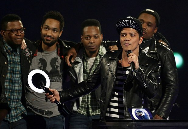 Bruno Mars collects the award for Best International Male Solo Artist during the 2014 Brit Awards at the O2 Arena, London.