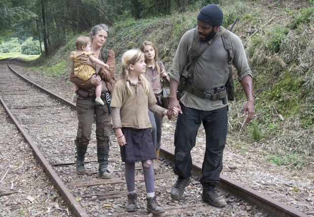 Carol (Melissa Suzanne McBride), Penny (Kylie Szymanski), Lizzie (Brighton Sharbino) and Tyreese (Chad Coleman) in The Walking Dead season 4 episode 10: 'Inmates'