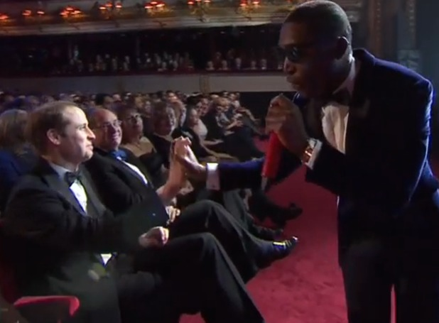 Tinie Tempah high-fives Prince William at the BAFTAs