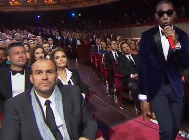 Brad Pitt watches Tinie Tempah at the BAFTAs