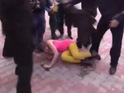 Nadezhda Tolokonnikova and Maria Alyokhina are beaten in a protest in Sochi.