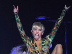 Miley Cyrus performs in underwear after missing costume change - video