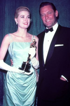 VARIOUS FILM STILLS OF 'COUNTRY GIRL' WITH AWARDS - OSCARS, 1954, ACADEMY AWARDS CEREMONIES, ACCESSORIES, AWARDS - ACADEMY, BEST ACTRESS, WILLIAM HOLDEN, GRACE KELLY, OSCAR (ACADEMY AWARD STATUE), HOLLYWOOD PANTAGES THEATRE, HOLDING AWARD, OSCAR RETRO, OSCAR (PERSONALITY) IN 1954 1954