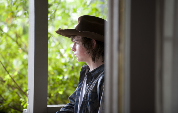 Chandler Riggs as Carl Grimes in The Walking Dead season 4 episode 11: 'Claimed'
