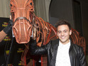 Olympic diver poses with life-size horse puppet Joey at special West End performance.