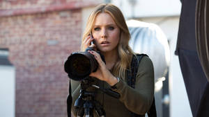Watch the first two minutes of Veronica Mars.