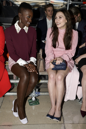 PARIS, FRANCE - MARCH 05: Actresses Lupita Nyong'o and Elizabeth Olsen attend the Miu Miu show as part of the Paris Fashion Week Womenswear Fall/Winter 2014-2015 on March 5, 2014 in Paris, France. (Photo by Pascal Le Segretain/Getty Images)