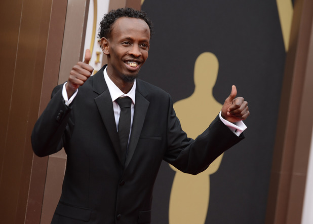 Barkhad Abdi arrives at the 86th Academy Awards.