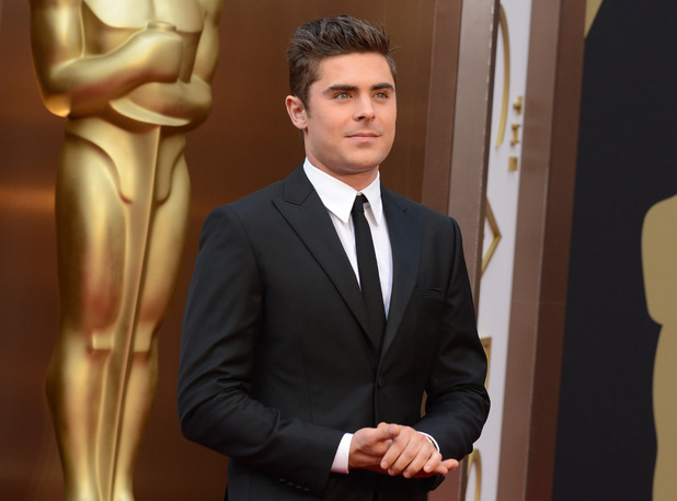 Zac Efron arrives at the Oscars on Sunday, March 2, 2014, at the Dolby Theatre in Los Angeles.
