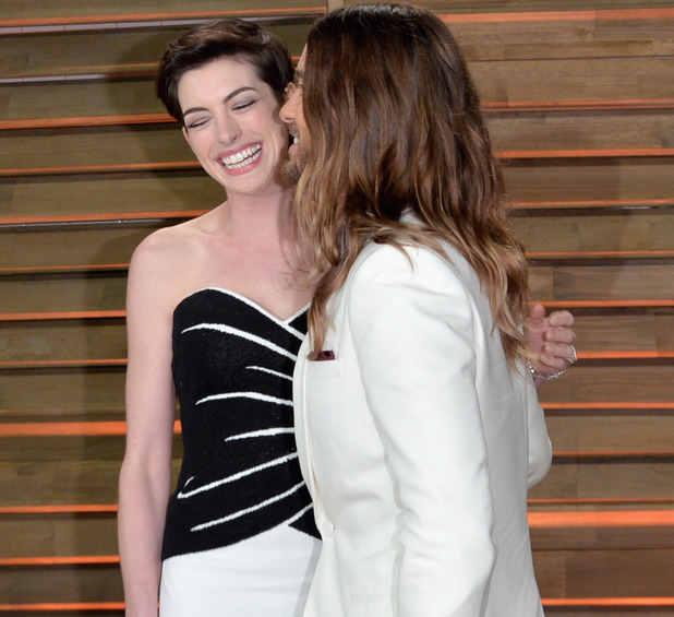 Anne Hathaway gets a kiss from Jared Leto