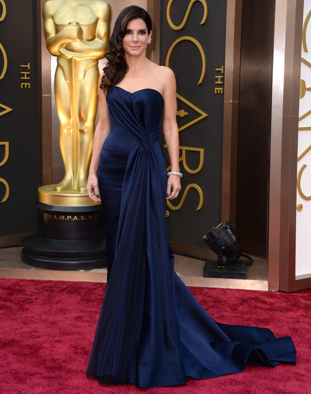 Sandra Bullock arrives at the Oscars on Sunday, March 2, 2014, at the Dolby Theatre in Los Angeles.