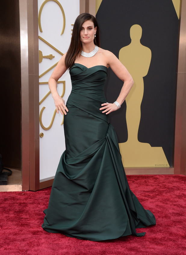Idina Menzel arrives at the 86th Academy Awards.