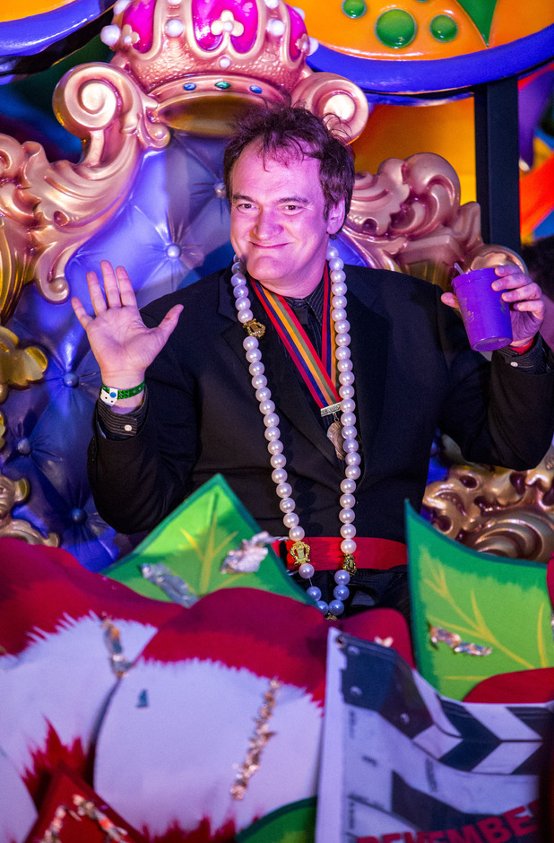 NEW ORLEANS, LA - MARCH 03: Celebrity monarch Quentin Tarantino rides in the 2014 Krewe Of Orpheus Parade on March 3, 2014 in New Orleans, Louisiana. (Photo by Skip Bolen/Getty Images)