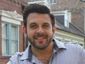 Adam Richman's new show Man Finds Food was delayed by the Travel Channel.