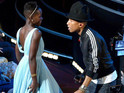 Pharrell gets the female nominees out of their seats with 'Happy' performance.