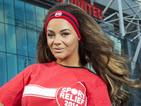 Chelsee Healey gets on her bike at the Old Trafford for Sport Relief