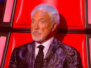 Tom Jones watches Jade Mayjean Peters perform during The Voice