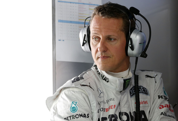 Michael Schumacher prepares to drive during practice for the Indian Formula One Grand Prix at Buddh International Circuit