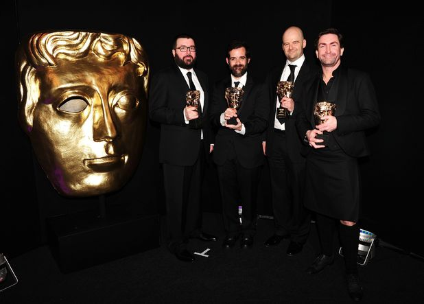 Aaron Garbut, Sam Houser, Dan Houser and Leslie Benzies of Rockstar Games, win the Fellowship Award at the British Academy Games Awards