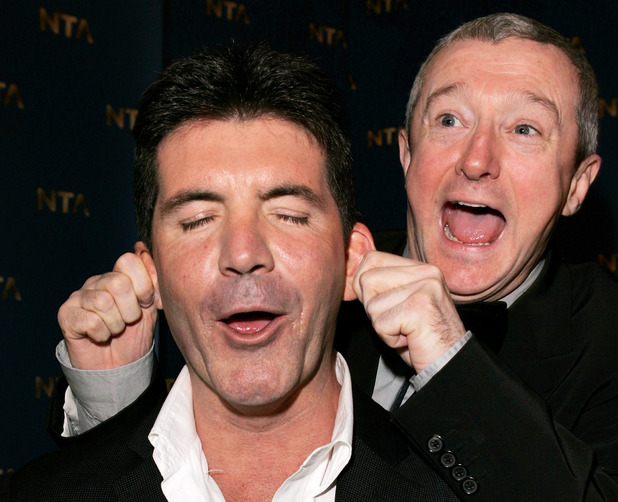 LONDON - OCTOBER 25: Music producers Simon Cowell (L) and Louis Walsh pose in the awards room during the National Television Awards 2005 at the Royal Albert Hall on October 25, 2005 in London, England. (Photo by Dave Hogan/Getty Images)