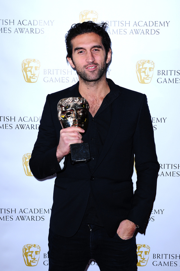 Josef Fares with the Game Innovation award, for Brothers:A Tale Of Two Sons at the British Academy Games Awards