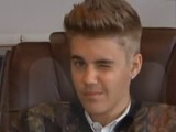 Justin Bieber winks during his deposition