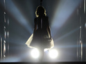 Taylor Swift shown in silhouette on the 'Red' tour - London, February 4, 2014