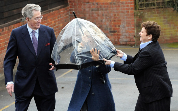A gust of wind catches The Duchess of Cornwall's umbrella as she arrives in Steeple Ashton, Wiltshire, to meet members of the Wiltshire Guild of Spinners, Weavers and Dyers. 2011