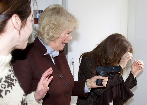 Prince Charles and Camilla Duchess of Cornwall Tour of Scandinavia, Copenhagen, Denmark - 27 Mar 2012 Camilla Duchess of Cornwall brandishing the prop gun of Sofie Grabol at Crown Princess Mary on the set of The Killing 27 Mar 2012