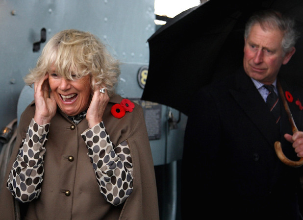 The Duchess of Cornwall puts her fingers in her ears as the Prince of Wales fires a gun on HMCS Haida in Hamilton, near Toronto in Canada. The Duchess learned of her Canadian roots today as she continues her tour of the North American country with the Prince of Wales.