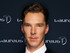 Benedict Cumberbatch poses with the Laureus trophy during the 2014 Laureus World Sports Awards