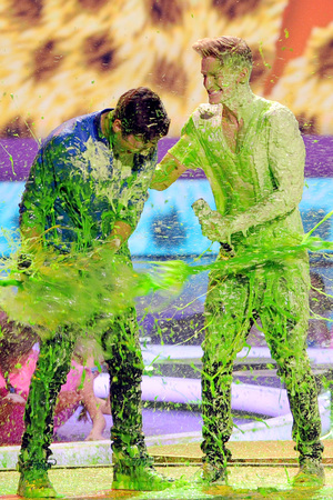 Austin Mahone and Cody Simpson get slimed at the Nickelodeon Kids Choice Awards 2014