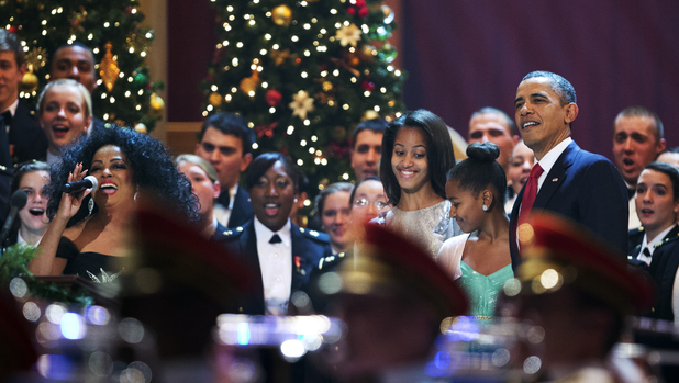 President Barack Obama, from right, with his daughters Sasha Obama and Malia Obama, join singer Diana Ross, left, and other performers, during the Annual Christmas in Washington presentation at the National Building Museum in Washington, Sunday, Dec. 9, 2012. (AP Photo/Manuel Balce Ceneta)