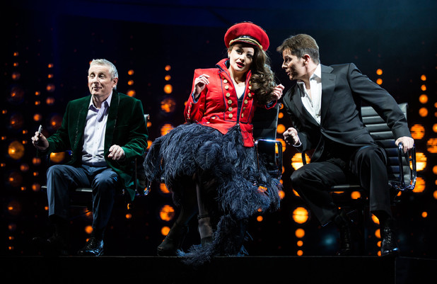 Ashley Knight as Louis, Victoria Elliott as Jordy and Nigel Harman as Simon Cowell in I Can't Sing! The X Factor Musical