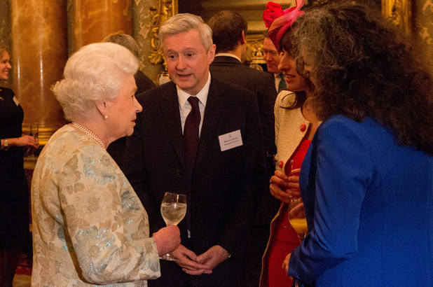 Queen Elizabeth II talks to Louis Walsh at the Irish Community Reception at Buckingham Palace