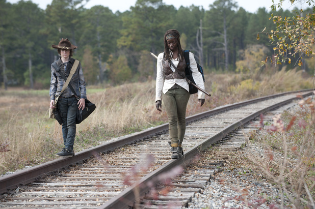 Carl Grimes (Chandler Riggs) and Michonne (Danai Gurira) in The Walking Dead S04E15: 'Us'