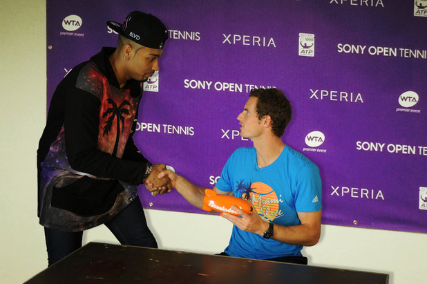 Jordan Banjo presents Andy Murray with his Nickelodeon Kids' Choice Award