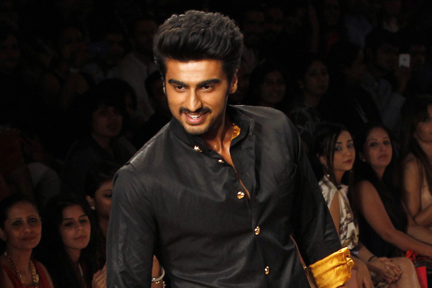 Arjun Kapoor displays a creation by Kunal Rawal during the Lakme fashion week in Mumbai, India