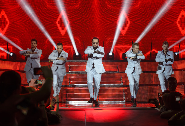 BIRMINGHAM, UNITED KINGDOM - MARCH 26: Kevin Richardson, Howie Dorough, Alexander James McLean, Brian Littrell and Nick Carter of Backstreet Boys perform on stage at LG Arena on March 26, 2014 in Birmingham, United Kingdom. (Photo by Steve Thorne/Redferns via Getty Images)