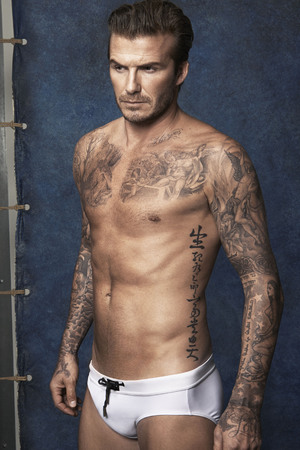 David Beckham poses in H&M swimwear