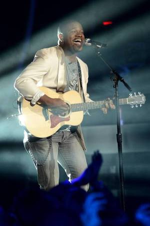 C.J. Harris performs on American Idol as part of the Top 8 performances