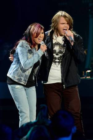 Jessica Meuse and Caleb Johnson perform on American Idol as part of the Top 8 performances