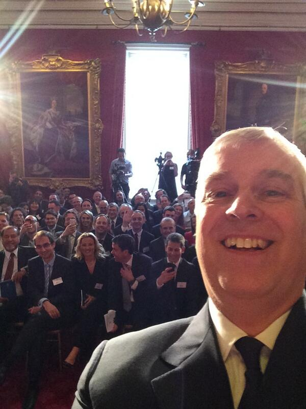 Prince Andrew takes a selfie during a speech at St James's Palace