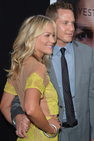 Caption:WESTWOOD, CA - APRIL 10: Actors Cynthia Daniel and Cole Hauser attend the premiere of Warner Bros. Pictures and Alcon Entertainment's 'Transcendence' at Regency Village Theatre on April 10, 2014 in Westwood, California. (Photo by Lester Cohen/Getty Images)