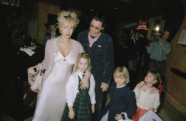 Paula Yates and daughters attend a charity premiere after-party for 'A Little Princess' at Planet Hollywood in London 1996