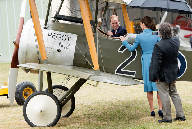 Caption:BLENHEIM, NEW ZEALAND - APRIL 10: Catherine, Duchess of Cambridge and Sir Peter Jackson look at Prince William, Duke of Cambridge sit in a plane at a WW1 commemorative and Flying Day at Omaka Aviation Heritage Centre on April 10, 2014 in Blenheim, New Zealand. The Duke and Duchess of Cambridge are on a three-week tour of Australia and New Zealand, the first official trip overseas with their son, Prince George of Cambridge. (Photo by Samir Hussein/WireImage)