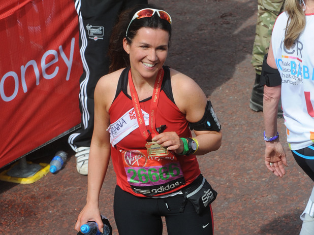 Susanna Reid poses at the finish line at the Virgin London Marathon 2013